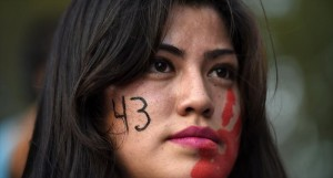 A-young-woman-takes-part-in-a-demonstration-demanding-information-on-the-whereabouts-of-the-43-missing-students-in-Mexico-City-on-Nov.-5-2014-AFP-800x430