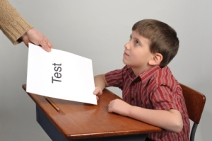 A boy receiving a failing test score
