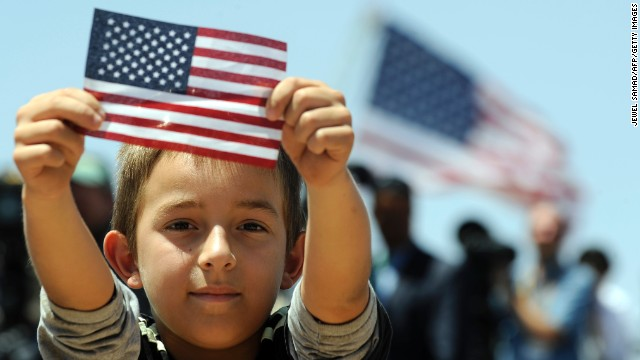 140702141351-immigration-boy-american-flag-story-top
